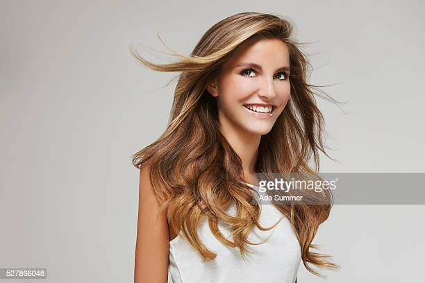 profile of woman with windblown wavy hair