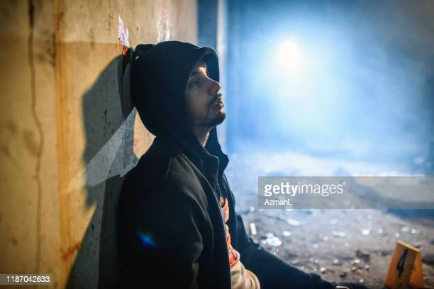 profile of young african male crime scene victim - murder victim stock pictures, royalty-free photos & images
