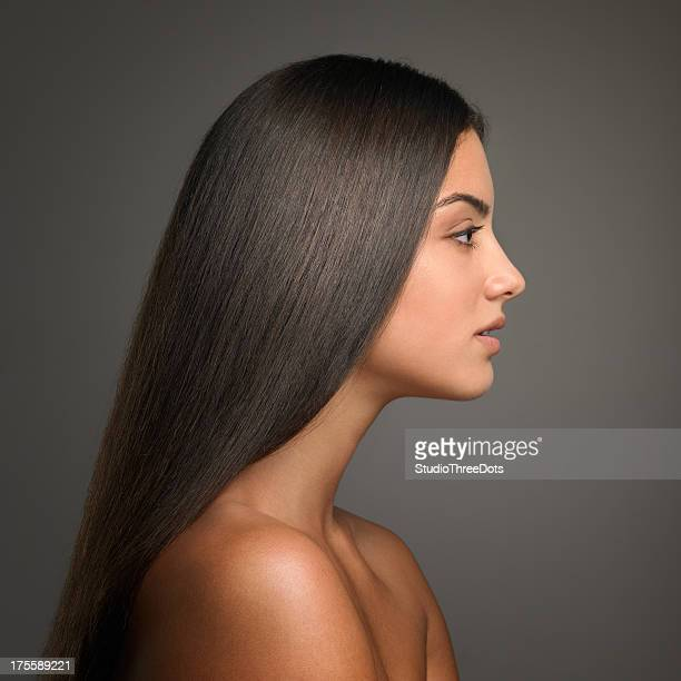 profile of young attractive brunette with straight hair