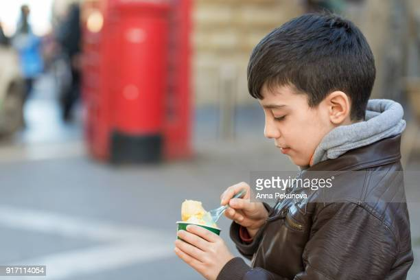 Profile of young boy eating ice-cream