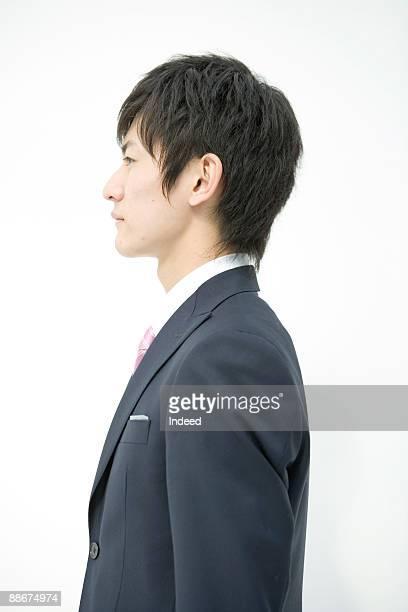 profile of young businessman, side view - 横からの視点 ストックフォトと画像