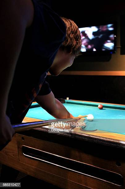 Profile of young man playing snooker game
