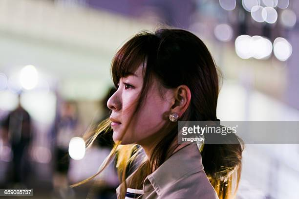 Profile of Young woman at night