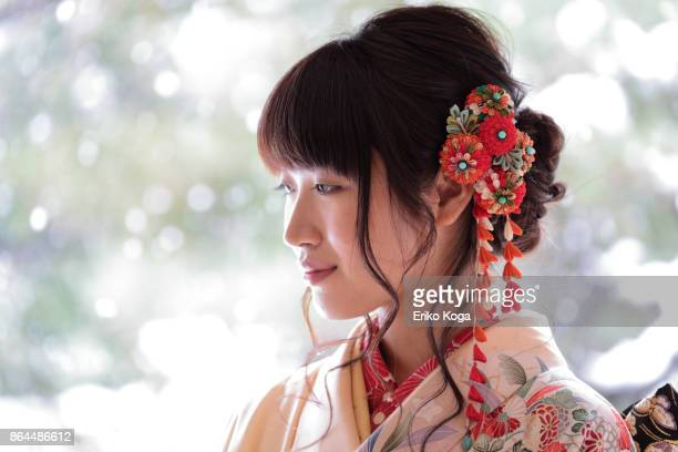 profile of young woman attached hair ornament for coming‐of‐age ceremony - seijin no hi stock pictures, royalty-free photos & images