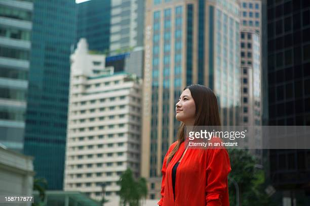 Profile of young woman in city