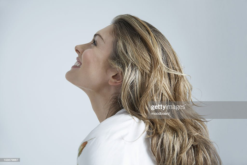 Profile of young woman smiling : Stock Photo