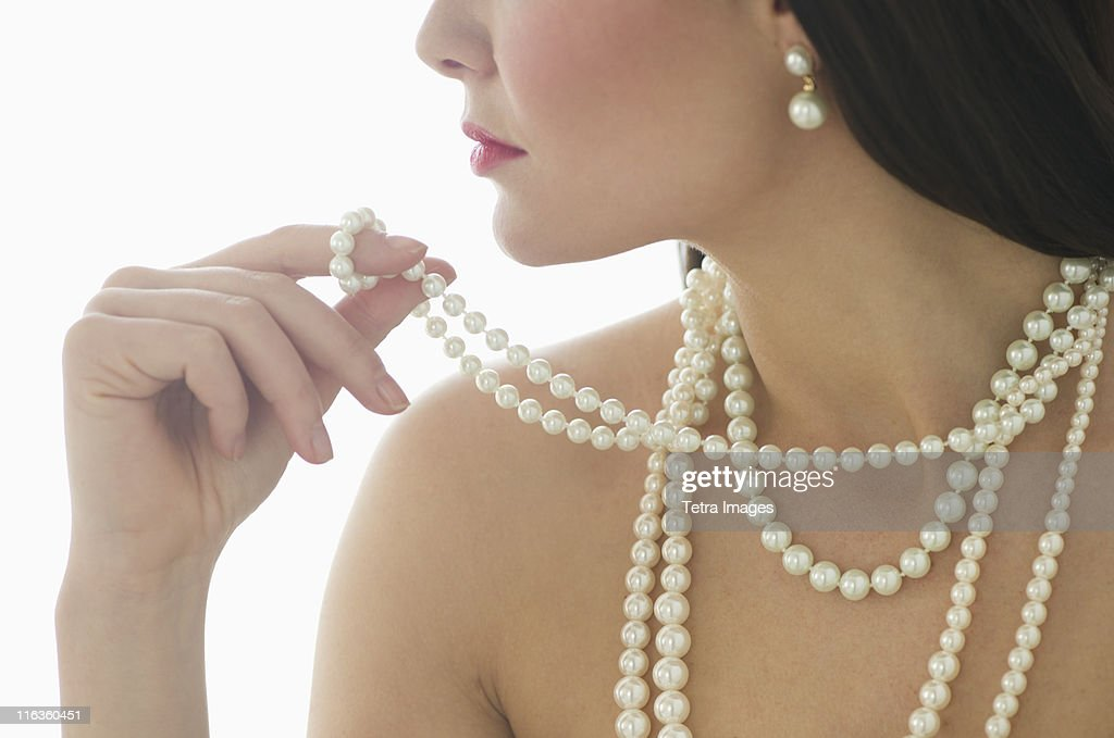 Profile of young woman wearing pearls : ストックフォト