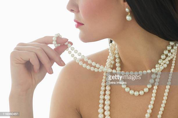 Profile of young woman wearing pearls