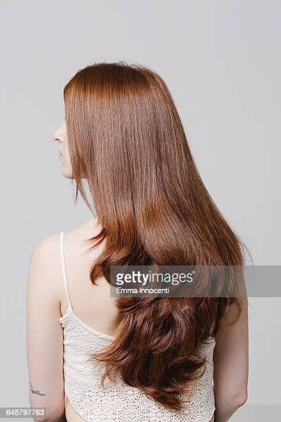 profile of young woman with beautiful red hair - ロングヘア ストックフォトと画像