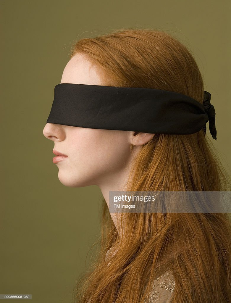 Profile of young woman with blindfold, head and shoulders : Stock Photo