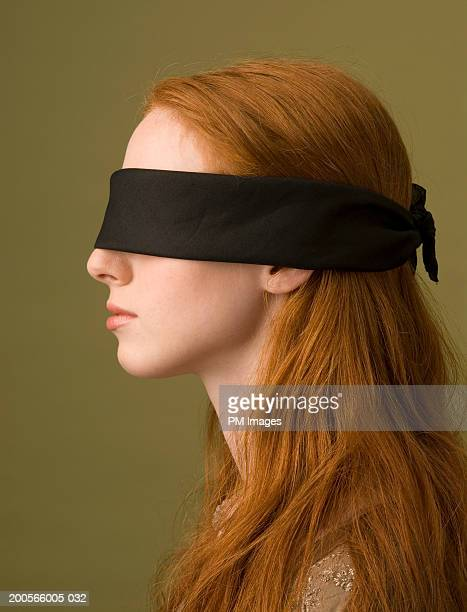 Profile of young woman with blindfold, head and shoulders