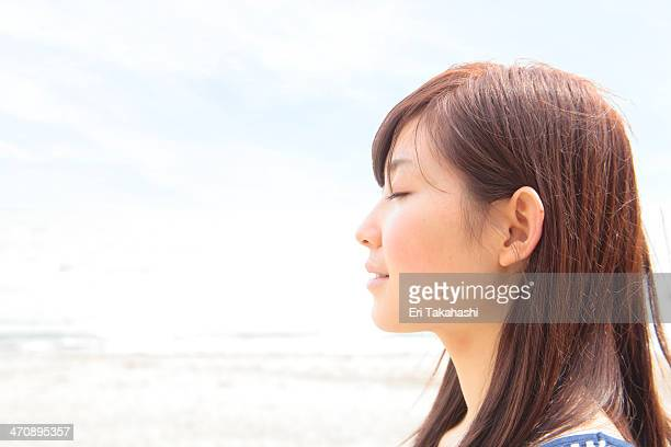 Profile of young woman with eyes closed