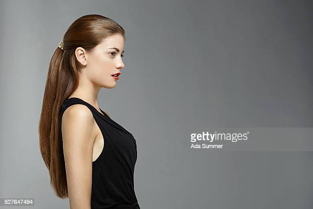 Profile of young woman with ponytail