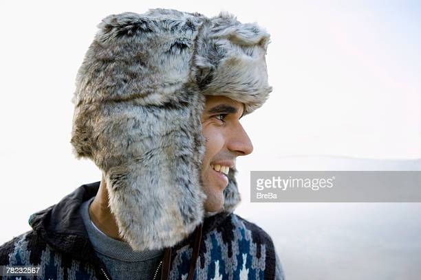 profile os smiling man wearing fur hat - vinter os bildbanksfoton och bilder