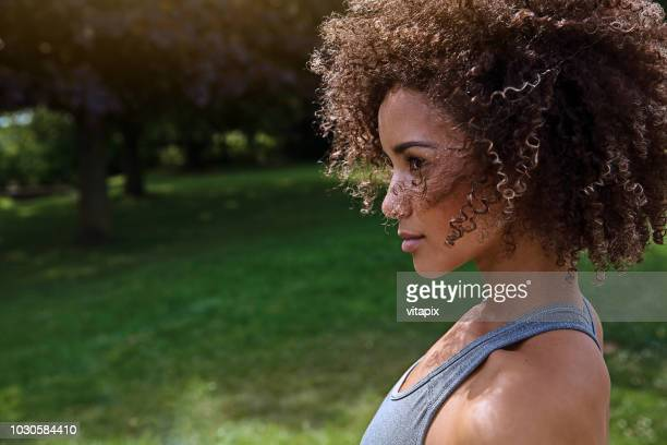 profile portrait of a confident sporty woman - afro stock photos and pictures
