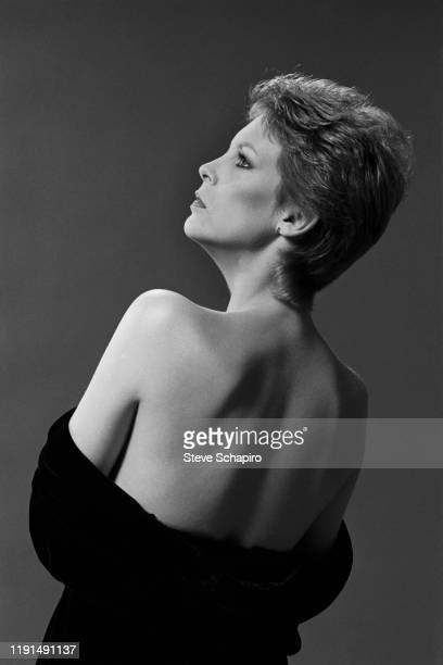 Profile portrait of American actress Jamie Lee Curtis as she poses with her shoulders bared Los Angeles California 1983