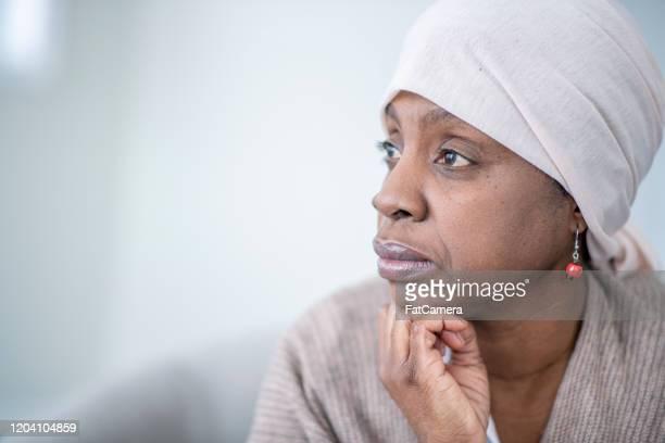 がんストック写真を持つアフリカの女性のプロフィール写真 - 悪性腫瘍 ストックフォトと画像