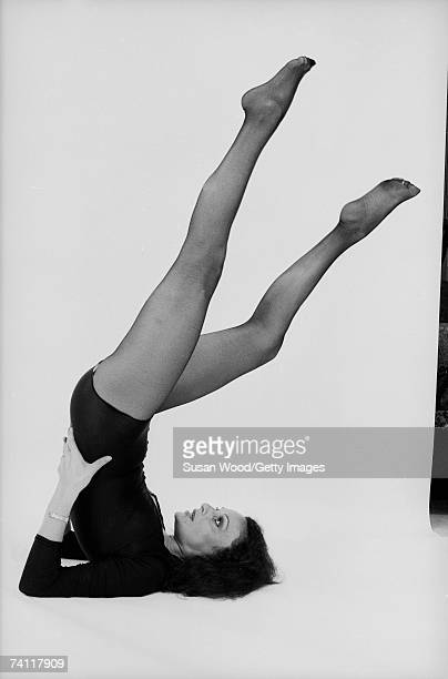 Profile portrait of Belgianborn American fashion designer Diane von Furstenberg in a yoga pose with her legs in the air June 16 1977