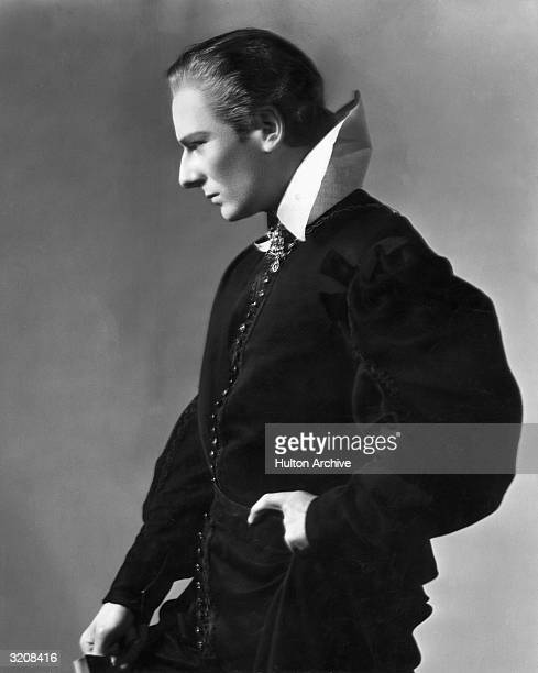 Profile portrait of British actor John Gielgud posing in costume for his lead role in the William Shakespeare play 'Hamlet'