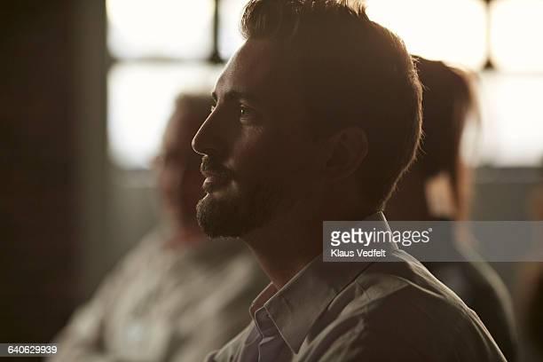 profile portrait of businessman at convention - motivación fotografías e imágenes de stock