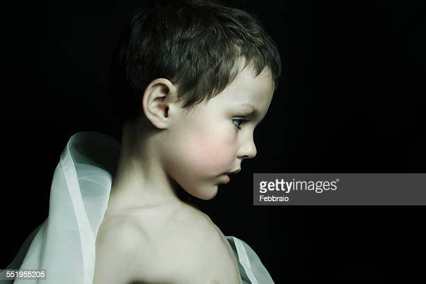 Profile portrait of child wearing a cloth