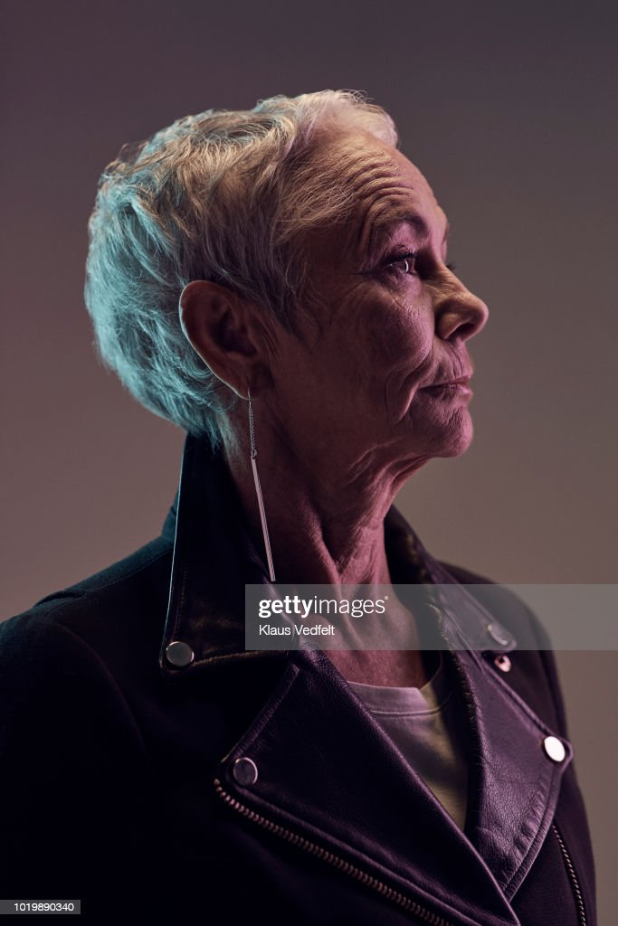 Profile portrait of cool mature woman, with coloured lights : Stock Photo