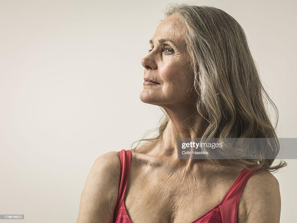 Profile portrait of senior female in sports top
