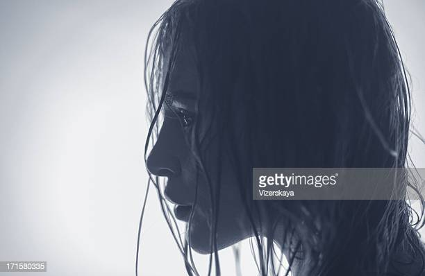 Profile portrait of young women with wet hair