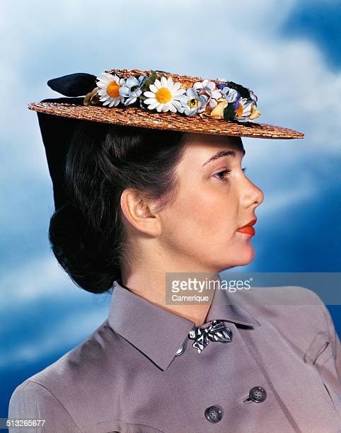 Profile portrait woman wearing gray suit straw hat with flowers Los Angeles California 1949