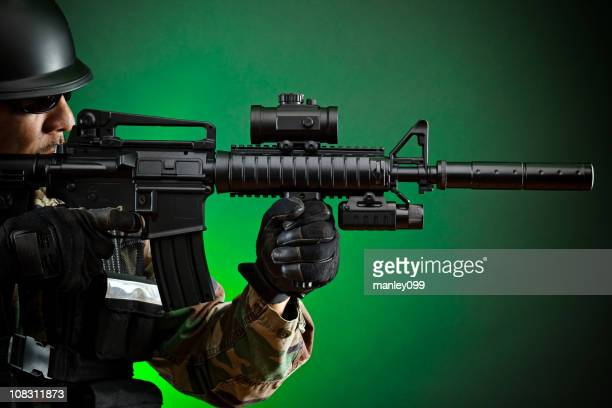 profile shot of army soldier aiming
