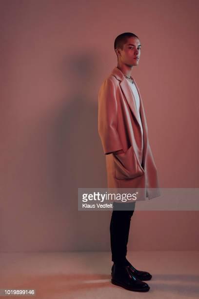 profile shot of beautiful young man, shot on studio - mani in tasca foto e immagini stock