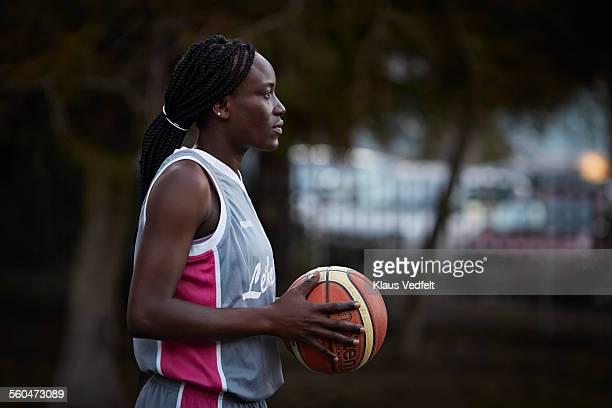 Profile shot of cool female baskeball player