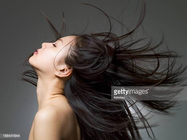 profile shot of the woman who looks up - black hair stock pictures, royalty-free photos & images