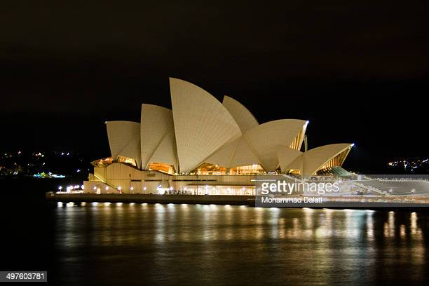 Profile shot of the world famous Sydney Opera House at night.
