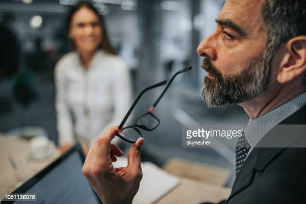 profile view of a pensive businessman on a meeting. - introspection stock pictures, royalty-free photos & images