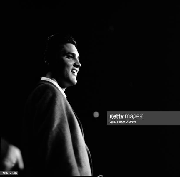Profile view of American singer and musician Elvis Presley on his second appearance on 'The Ed Sullivan Show' New York New York October 28 1956