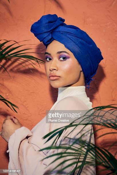 Profile view of beautiful woman in blue hijab