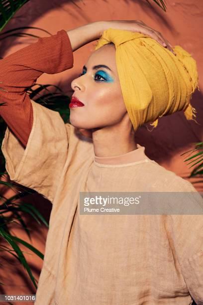 Profile view of beautiful woman in yellow hijab