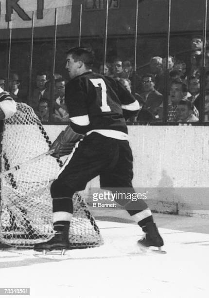 Profile view of Canadian hockey player Ted Lindsay of the Detroit Red Wings as he skates at the side of the New York Rangers net during a game New...
