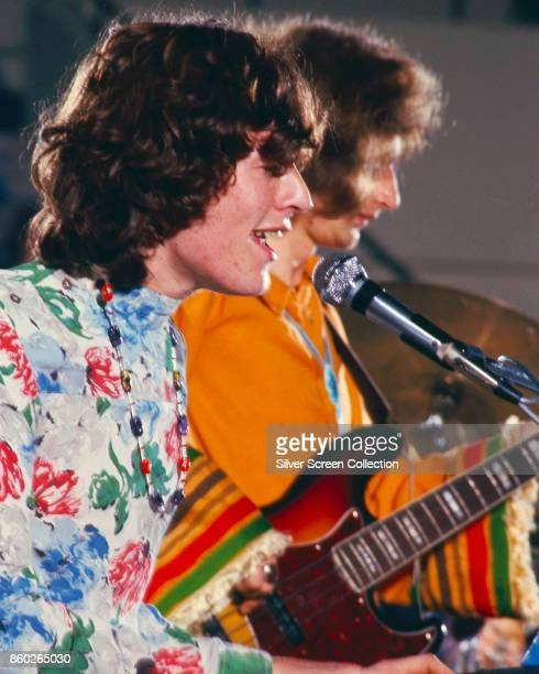 Profile view of English musicians Steve Winwood and Ric Grech both of the group Traffic as they perform early 1970s