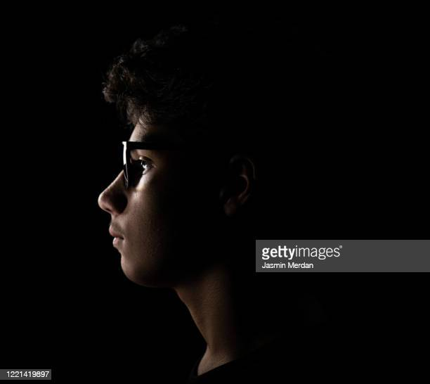 profile view of teenager with glasses - profile stock pictures, royalty-free photos & images