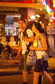 profile view walking caucasian backpacker couple