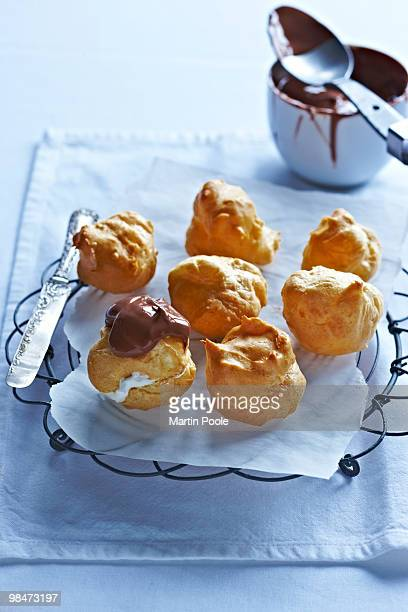 profiteroiles on baking rack being made up