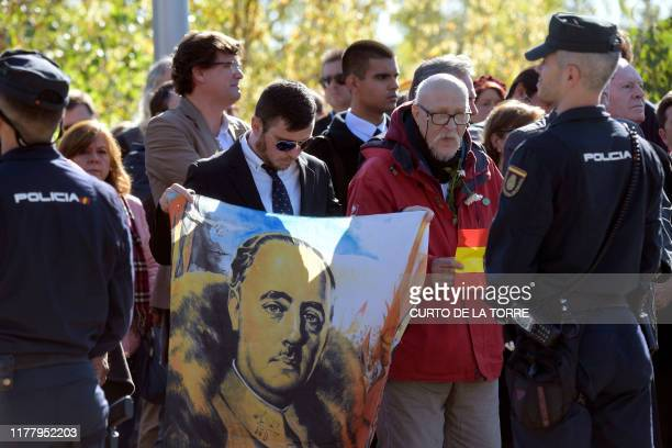 ProFranco supporters gather outside the cementery of MingorrubioEl Pardo in Madrid after the general's exhumation form the Valle de los Caidos...