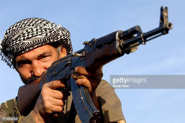 A progoverment village guard with an AK47 patrols near Uludere on October 23 2007 in the southeastern Turkish province of Sirnak at the TurkeyIraq...