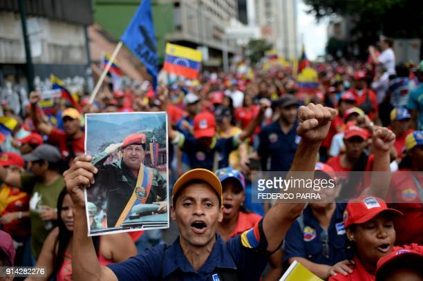 Progovernment activists cheer during a rally to commemorate the 26th anniversary of late Venezuelan President Hugo Chavez's 1992 military coup...