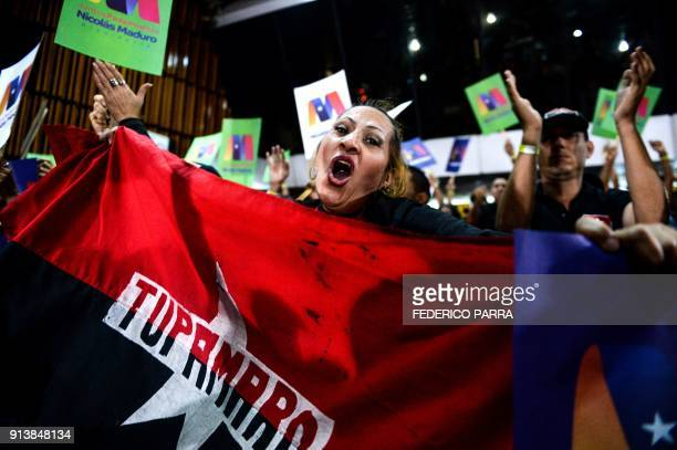 TOPSHOT Progovernment activists demonstrate their support for Venezuelan President Nicolas Maduro during a rally in Caracas on February 3 2018...