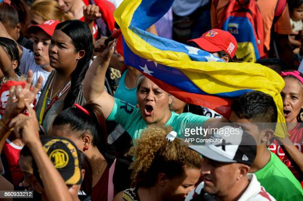 Progovernment activists demonstrate their support to Venezuelan deputy and gubernatorial candidate Hector Rodriguez during the closing ceremony of...