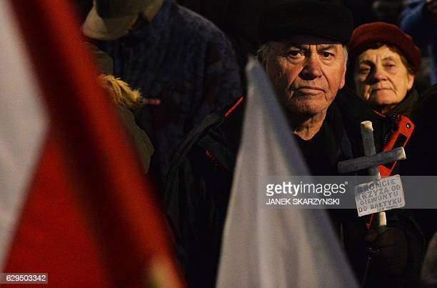 Progovernment demonstrators attend a rally on the 35th anniversary of the martial law in Warsaw on December 13 2016 General Wojciech Jaruzelski a key...