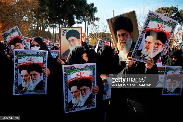 TOPSHOT Progovernment demonstrators hold posters of Iran's supreme leader Ayatollah Ali Khamenei and Iran's founder of Islamic Republic Ayatollah...